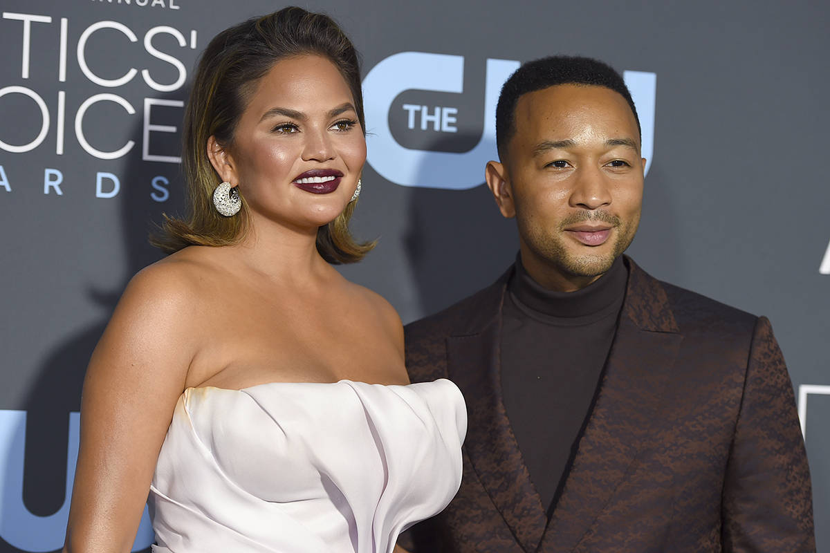 Chrissy Teigen, left, and John Legend arrive at the 24th annual Critics' Choice Awards on Jan. ...