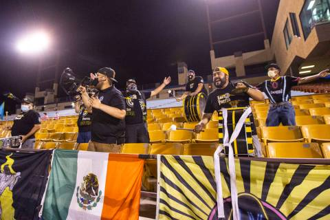 Las Vegas Lights FC fans cheer at the start of a USL Championship soccer game against Orange Co ...
