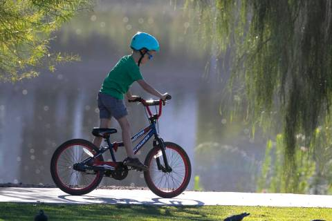 Riley Lowe, 7, rides his bike on a sunny morning at Cornerstone Park on Thursday, Oct. 1, 2020, ...