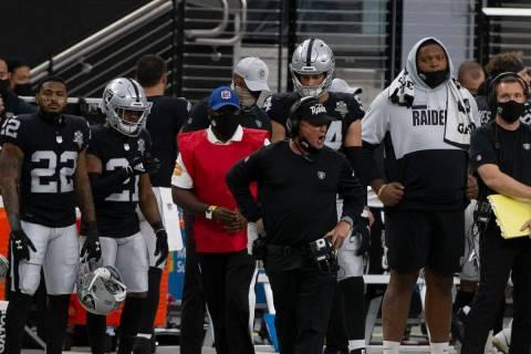 Las Vegas Raiders head coach Jon Gruden, center, reacts after Las Vegas Raiders quarterback Der ...