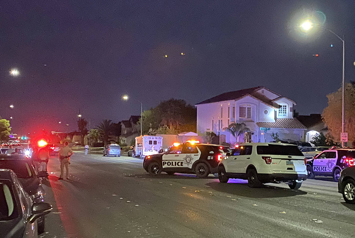 Las Vegas police investigate a homicide near Captain Hills Road and Boseck Drive in northwest L ...