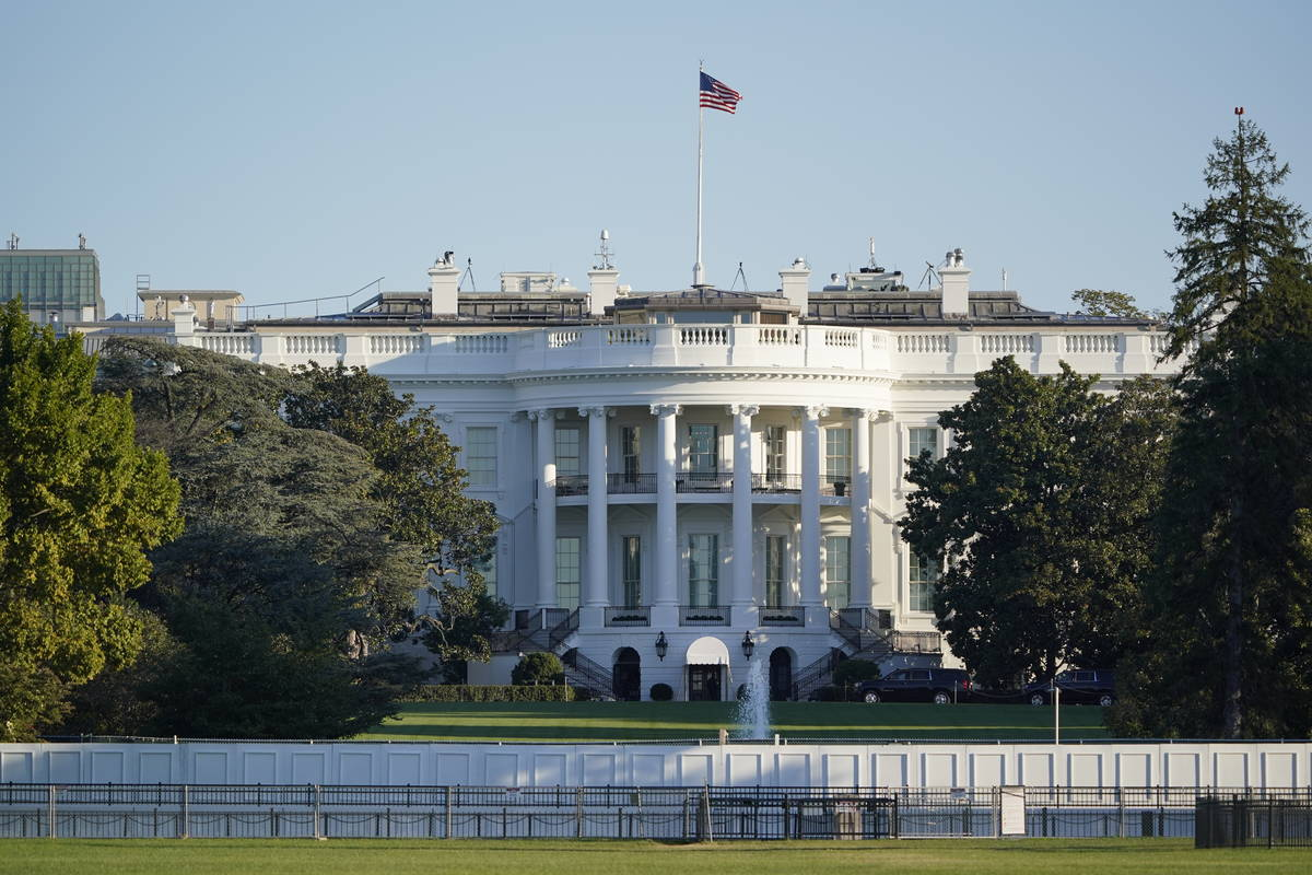 The White House is seen in Washington, early Saturday, Oct. 3, 2020, the morning after Presiden ...