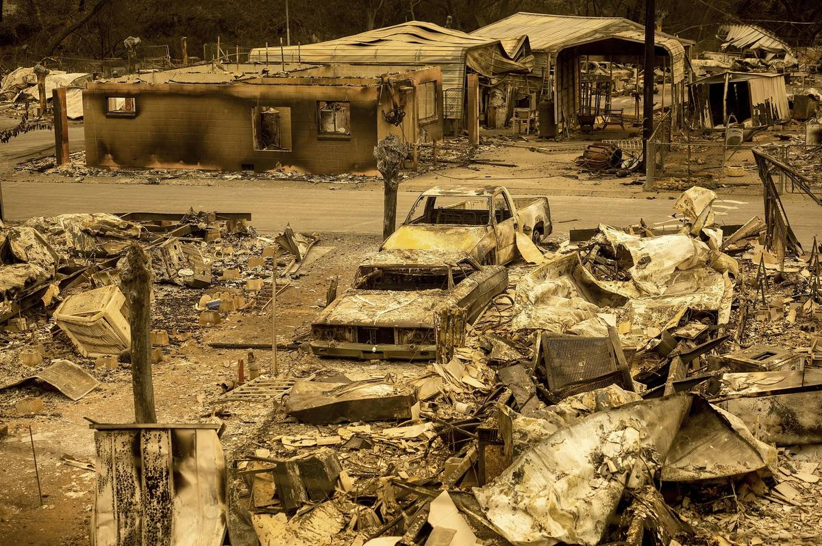In this Aug. 20, 2020, file photo, scorched homes and vehicles fill Spanish Flat Mobile Villa f ...