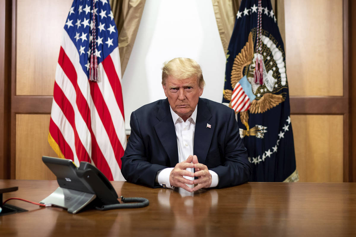 In this image provided by the White House, President Donald Trump listens during a phone call w ...