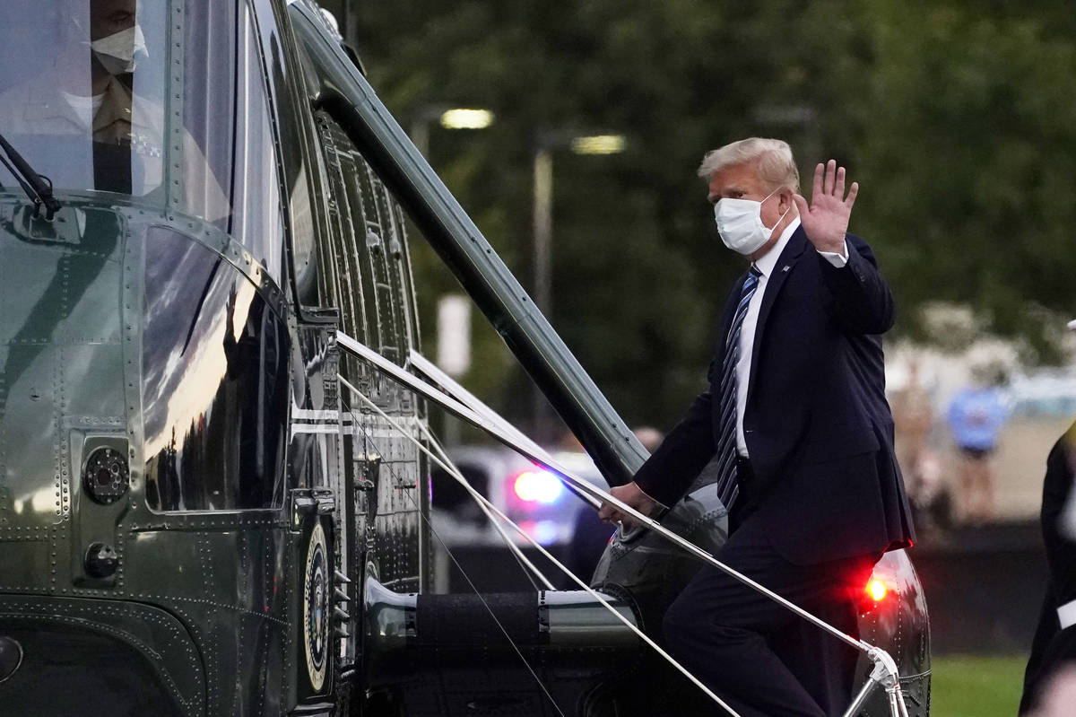 President Donald Trump boards Marine One to return to the White House after receiving treatment ...