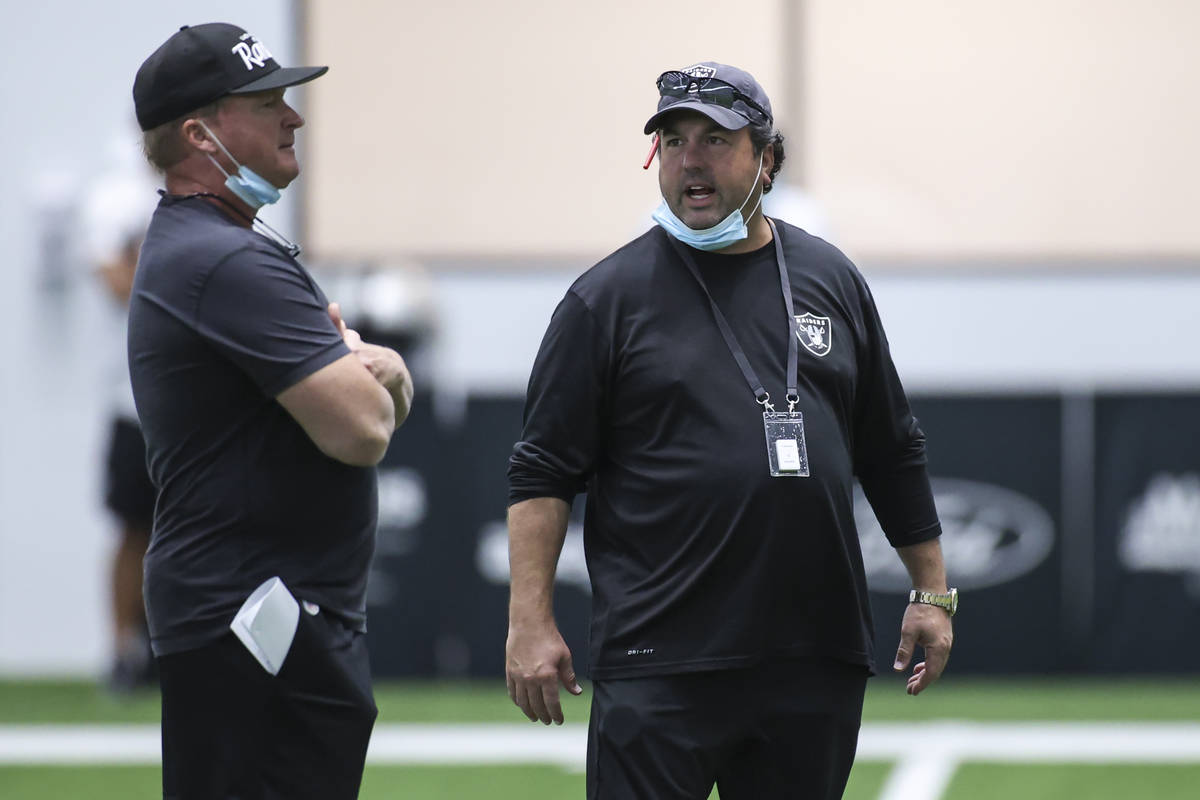 Las Vegas Raiders head coach Jon Gruden, left, talks with defensive coordinator Paul Guenther d ...