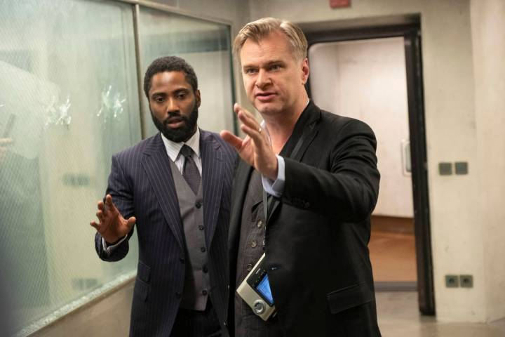 John David Washington, left, and director/writer/producer Christopher Nolan on the set of Warne ...
