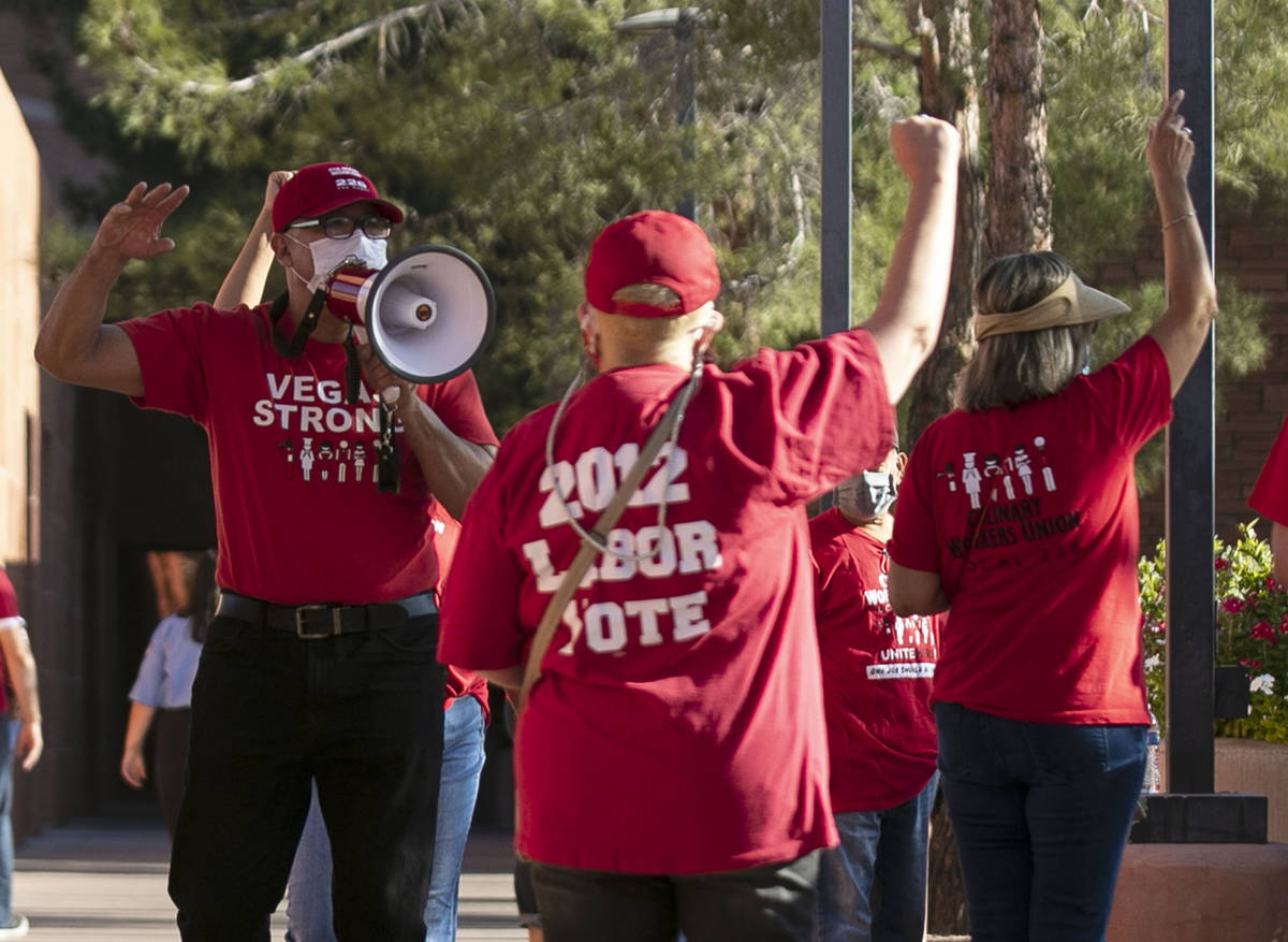 Jose Rivera, left, rally organizer, shouts slogans as he joins a rally outside of the Clark Co ...