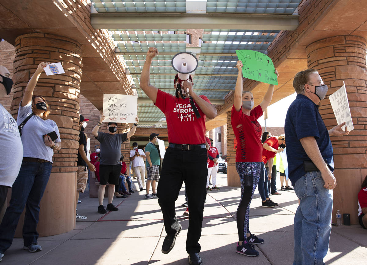 Jose Rivera, center, rally organizer, shouts slogans as he joins a rally outside of the Clark C ...