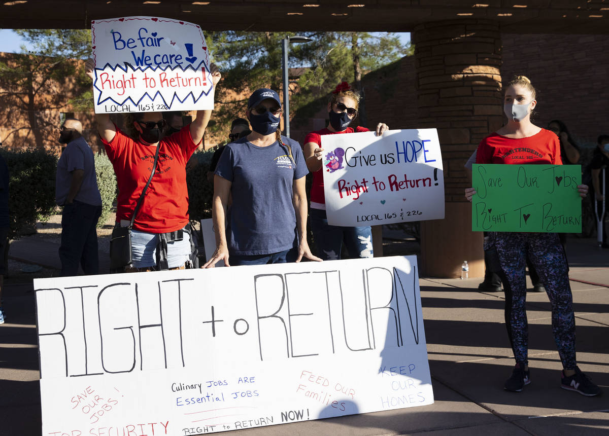 Workers, including Renee Fountain, second left, a worker at HMS Host at McCarran Airpot, rally ...