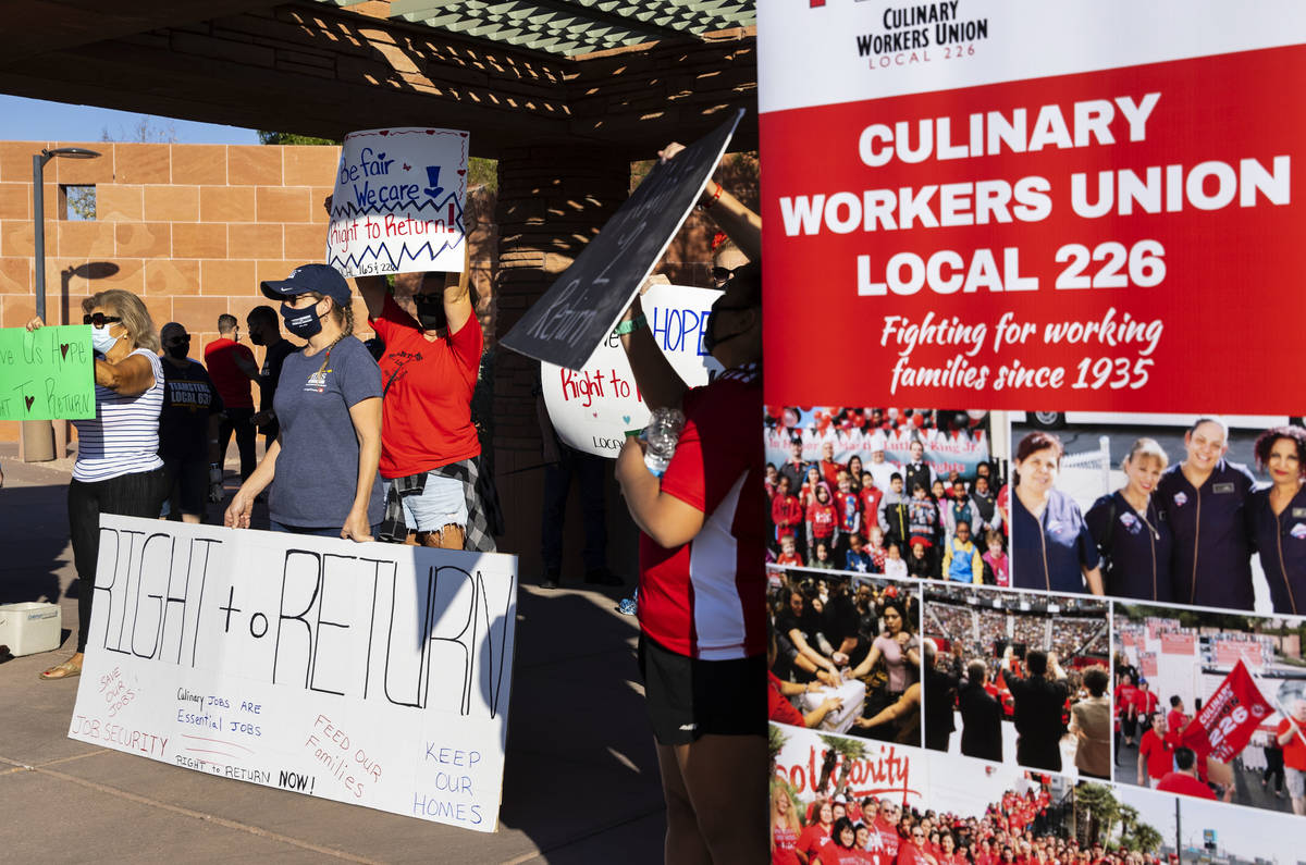 Workers rally outside of the Clark County Commission Building on Tuesday, Oct. 6, 2020, in Las ...