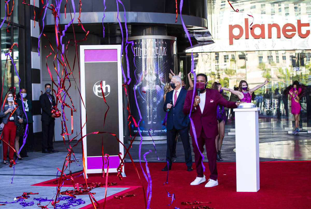 Confetti and streamers fall as actor Anthony Anderson marks the reopening of the Planet Hollywo ...