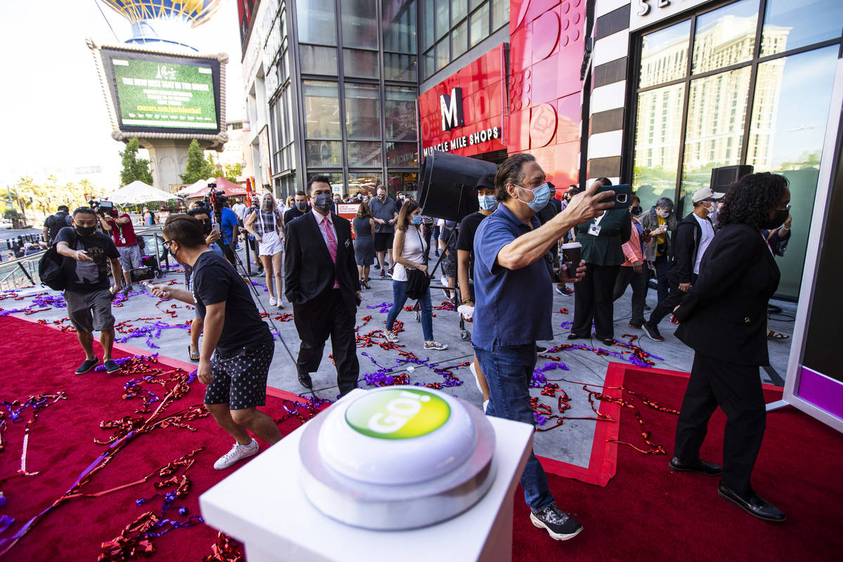 Guests head to the casino after the reopening of the Planet Hollywood Resort in Las Vegas on Th ...