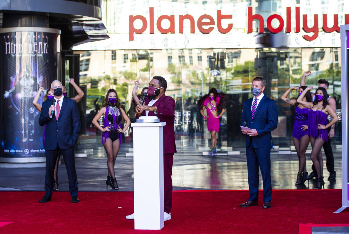 Actor Anthony Anderson gets ready to push a button to mark the reopening of the Planet Hollywoo ...