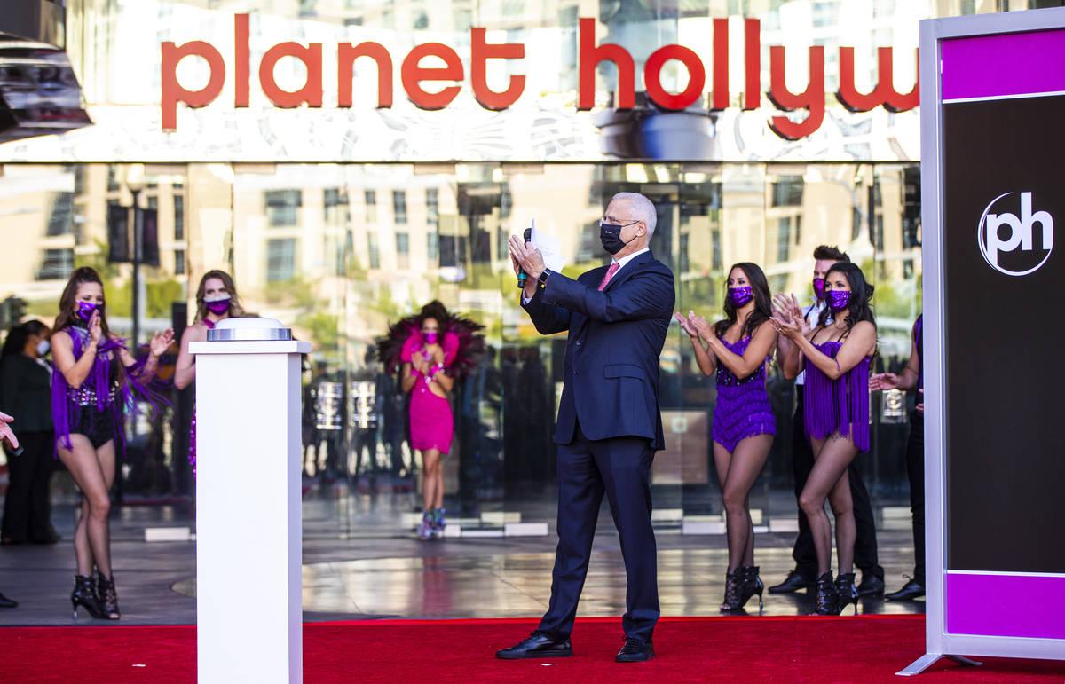 Gary Selesner, Caesars Entertainment regional president, applauds before the reopening of the P ...