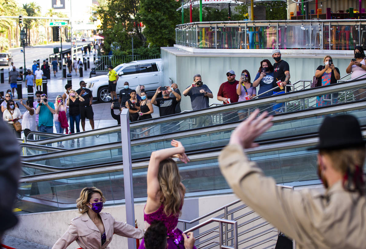 People watch as dancers perform to mark the reopening of the Planet Hollywood Resort in Las Veg ...