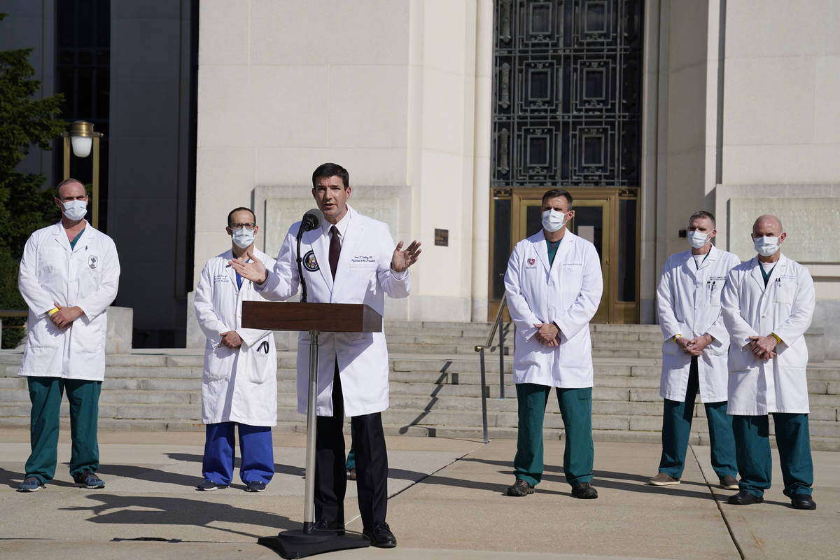 Dr. Sean Conley, physician to President Donald Trump, center, talks with reporters at Walter Re ...