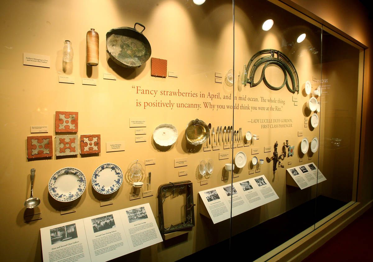 """A wall of serving utensils, dishes and tiles are shown at """"Titanic: The Artifact Exhibition"""" at ..."""