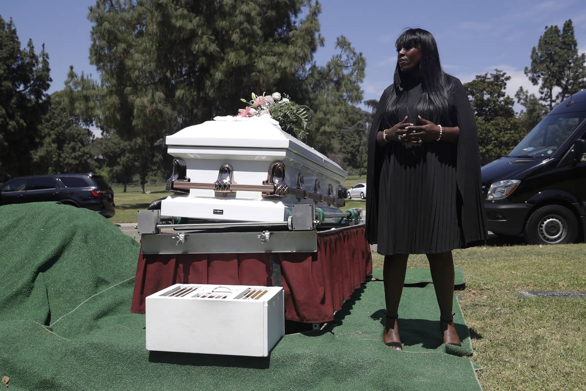 In this July 21, 2020, file photo, Candy Boyd, owner of Boyd Funeral Home, speaks to family mem ...