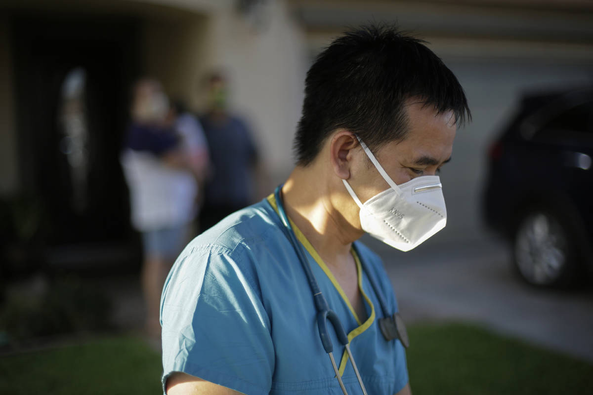 In this July 23, 2020, file photo, Dr. Tien Vo leaves after talking with a family quarantining ...