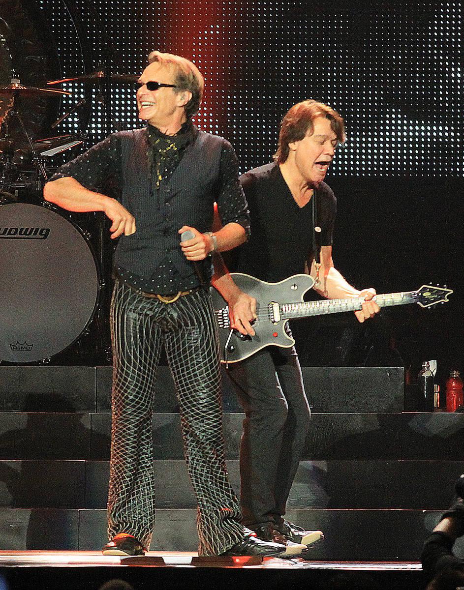 Lead singer David Lee Roth, left, and guitarist Eddie Van Halen of Van Halen perform at the MGM ...