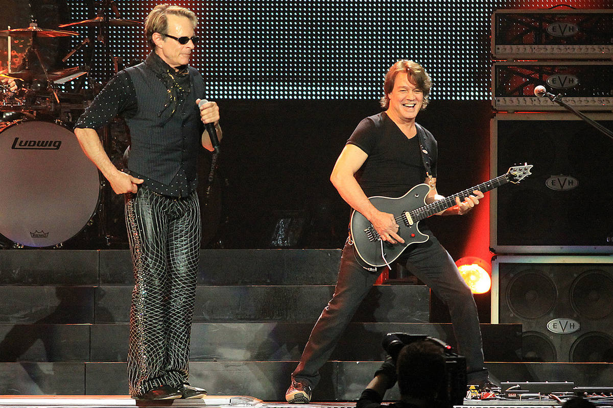 Eddie Van Halen, right, performs with lead singer David Lee Roth and the band Van Halen at the ...