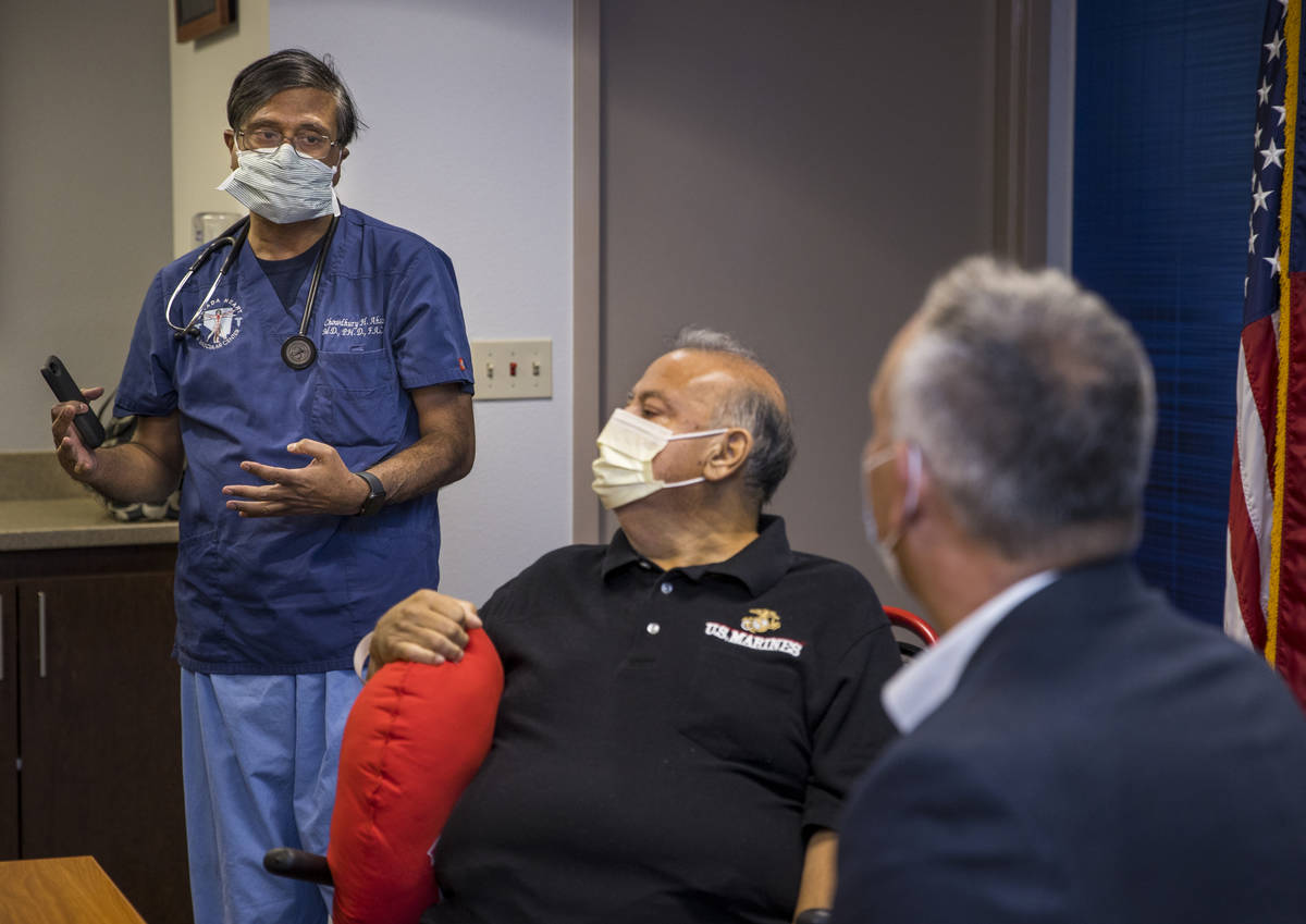 (From left) Dr. Chowdhury Ahsan talks about patient Pablo Bernabe with University Medical Cente ...