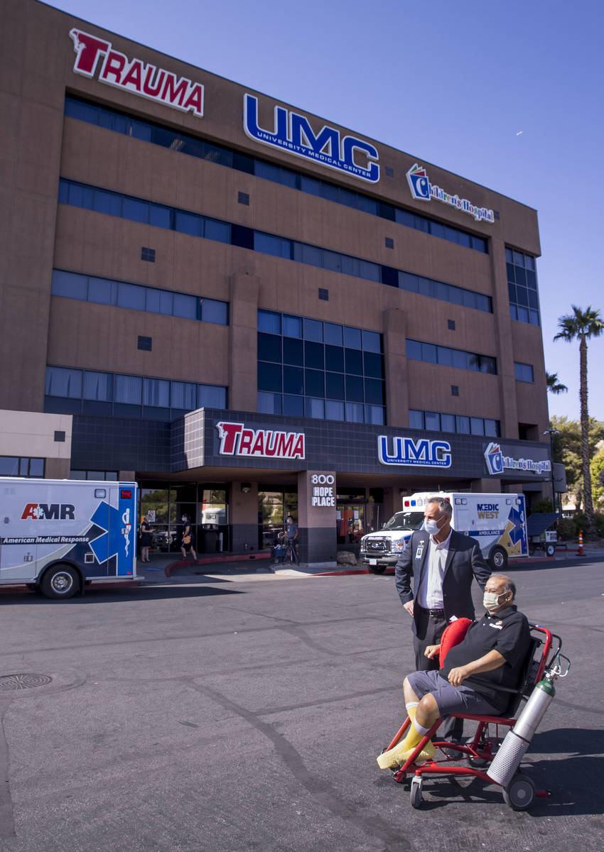 University Medical Center CEO Mason Van Houweling, above, waits with patient Pablo Bernabe as h ...