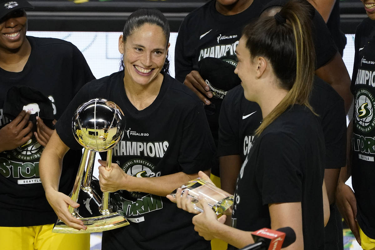 Seattle Storm guard Sue Bird, left, smiles at Breanna Stewart after the team defeated the Las V ...