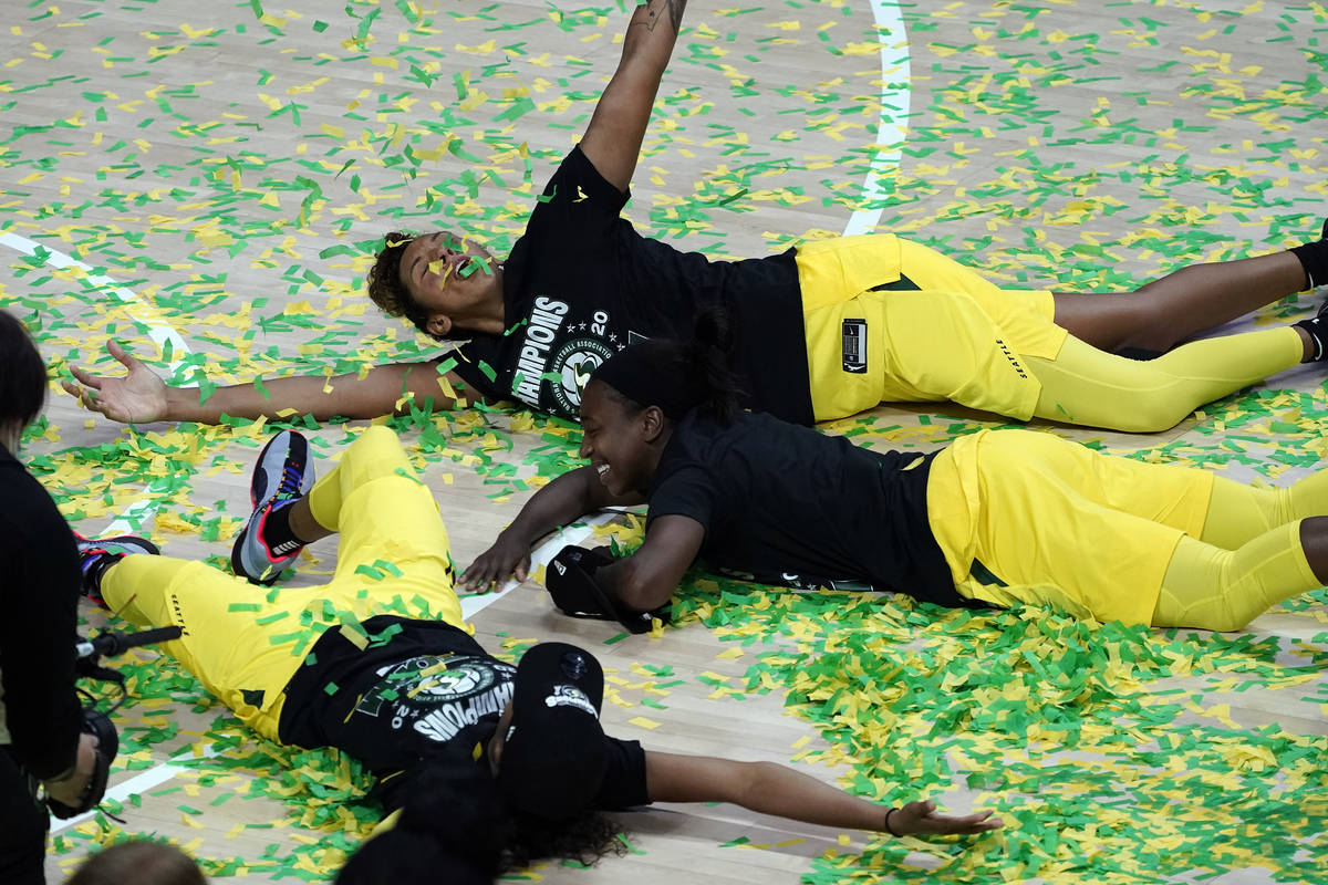 Seattle Storm players, including Mercedes Russell, top, play in the confetti after the team won ...