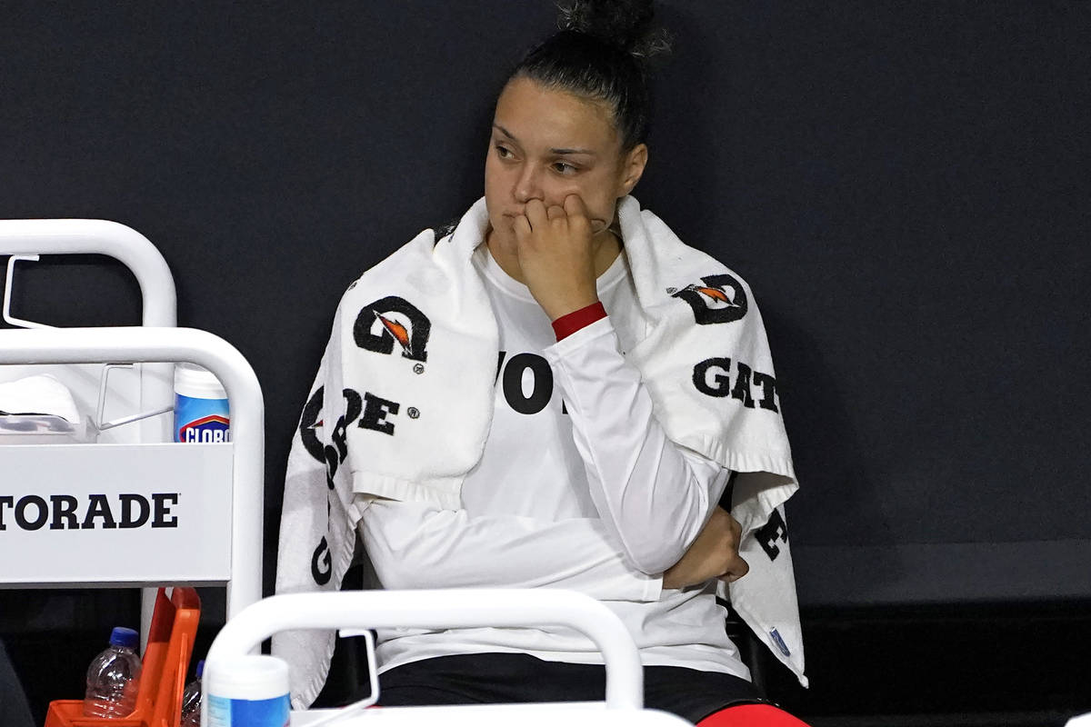Las Vegas Aces guard Kayla McBride reacts on the bench after the team lost to the Seattle Storm ...
