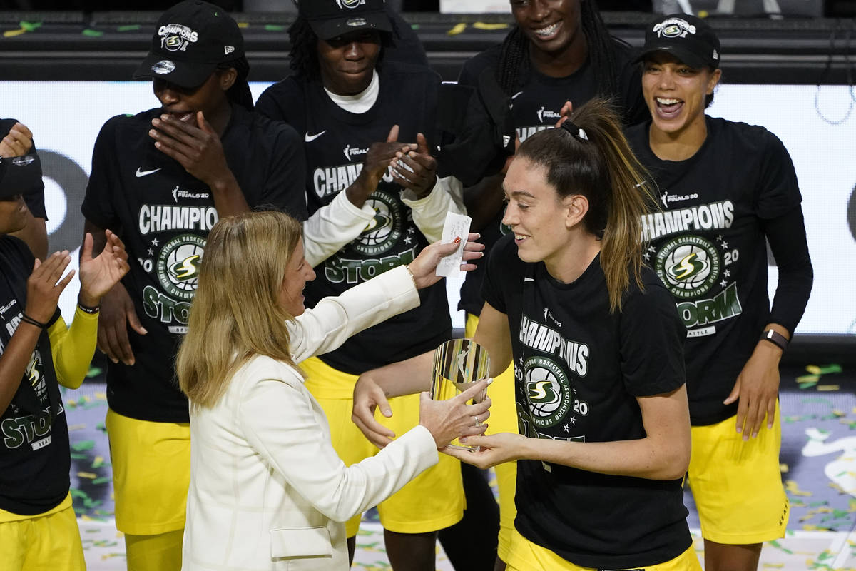 Seattle Storm forward Breanna Stewart, right, hugs WNBA Commissioner Cathy Engelbert after she ...