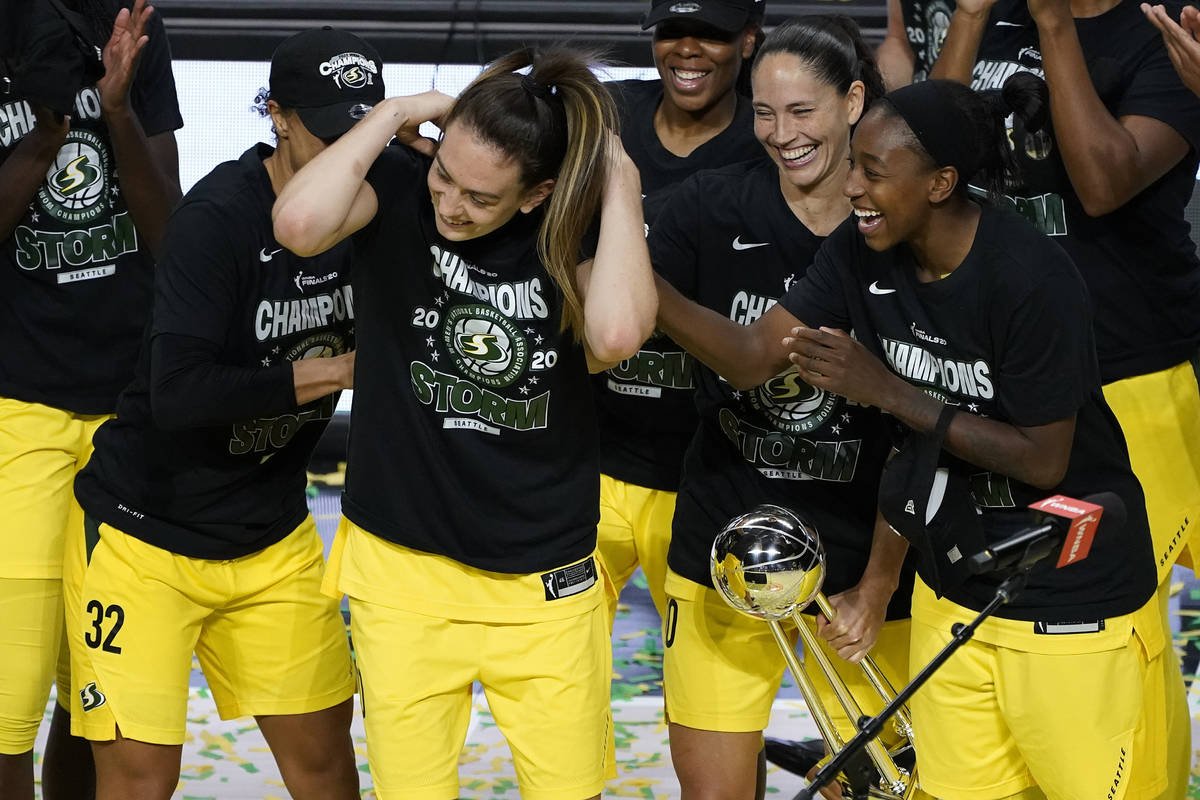 Seattle Storm forward Breanna Stewart, second from left, celebrates with teammates after being ...