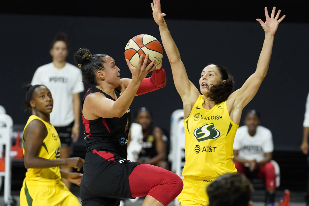 Las Vegas Aces guard Kayla McBride (21) shoots over Seattle Storm guard Jewell Loyd (24) and gu ...