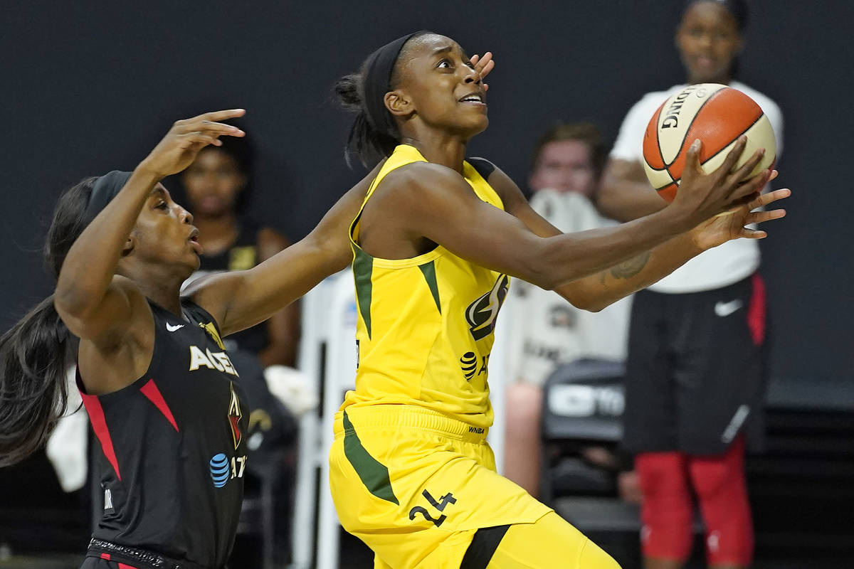 Seattle Storm guard Jewell Loyd (24) shoots after driving around Las Vegas Aces guard Jackie Yo ...