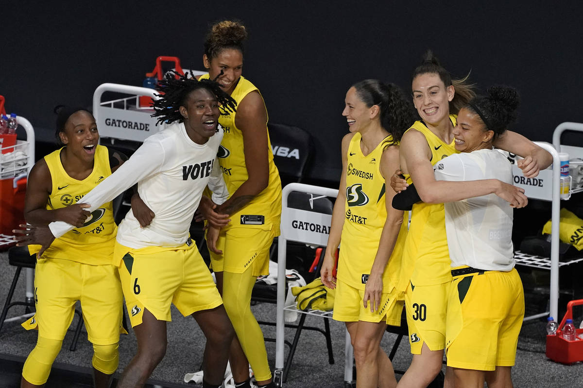 The Seattle Storm celebrate after defeating the Las Vegas Aces to win the WNBA championship Tue ...