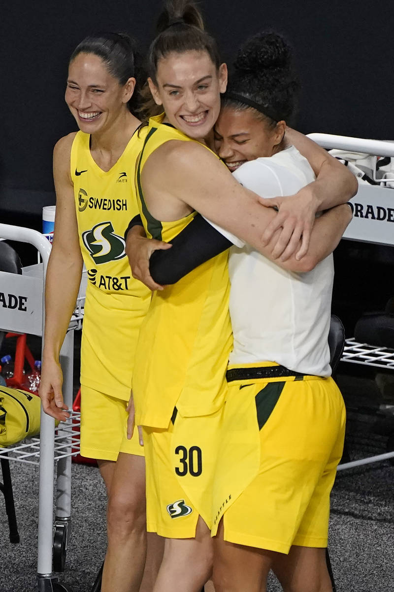 The Seattle Storm, from left, Sue Bird, Breanna Stewart, and Alysha Clark celebrate after the t ...