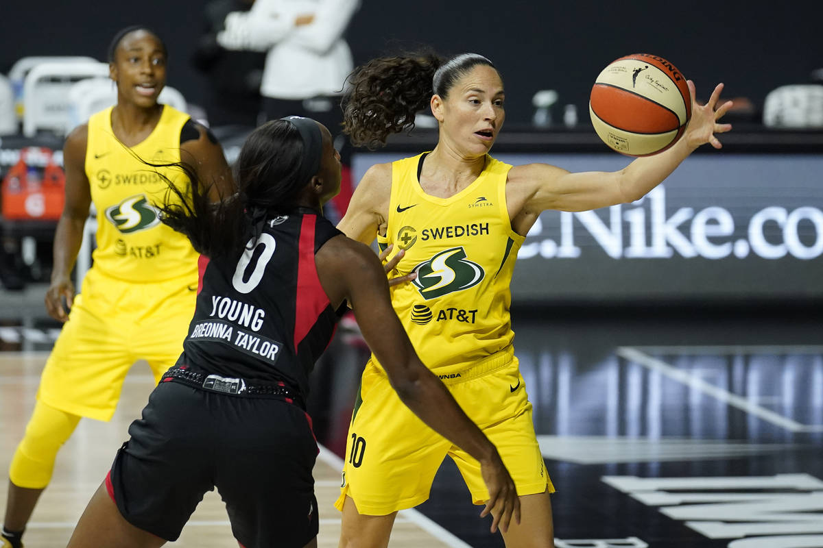 Seattle Storm guard Sue Bird (10) grabs the ball away from Las Vegas Aces guard Jackie Young (0 ...