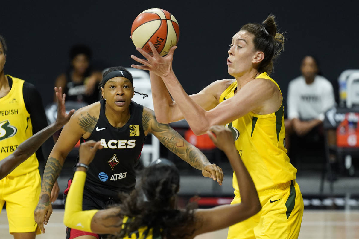 Seattle Storm forward Breanna Stewart (30) grabs a rebound away from Las Vegas Aces forward Emm ...