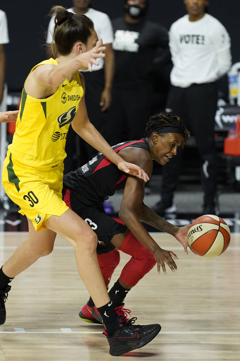 Las Vegas Aces guard Danielle Robinson (3) loses the ball as she tries to drive around Seattle ...