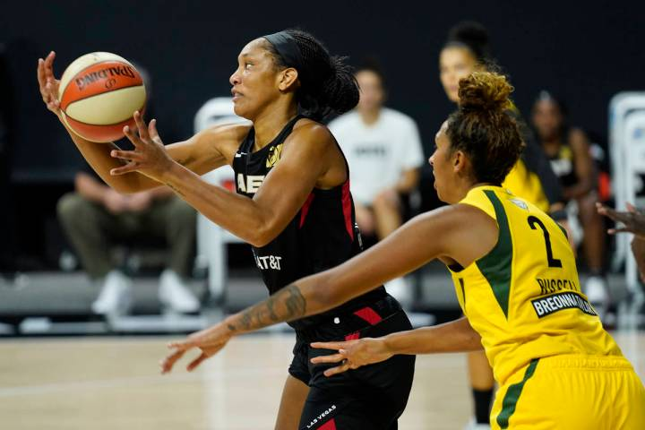 Las Vegas Aces center A'ja Wilson (22) grabs a pass while being guarded by Seattle Storm center ...