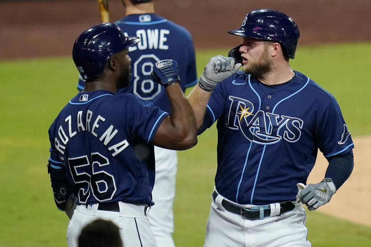 Tampa Bay Rays' Austin Meadows, right, greets Randy Arozarena after Meadows hit a solo home run ...