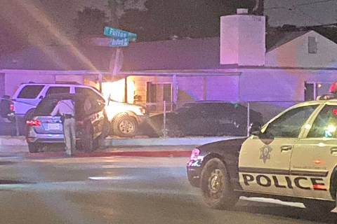 A driver was injured when a vehicle crashed into a street sign and took down the fence of a res ...
