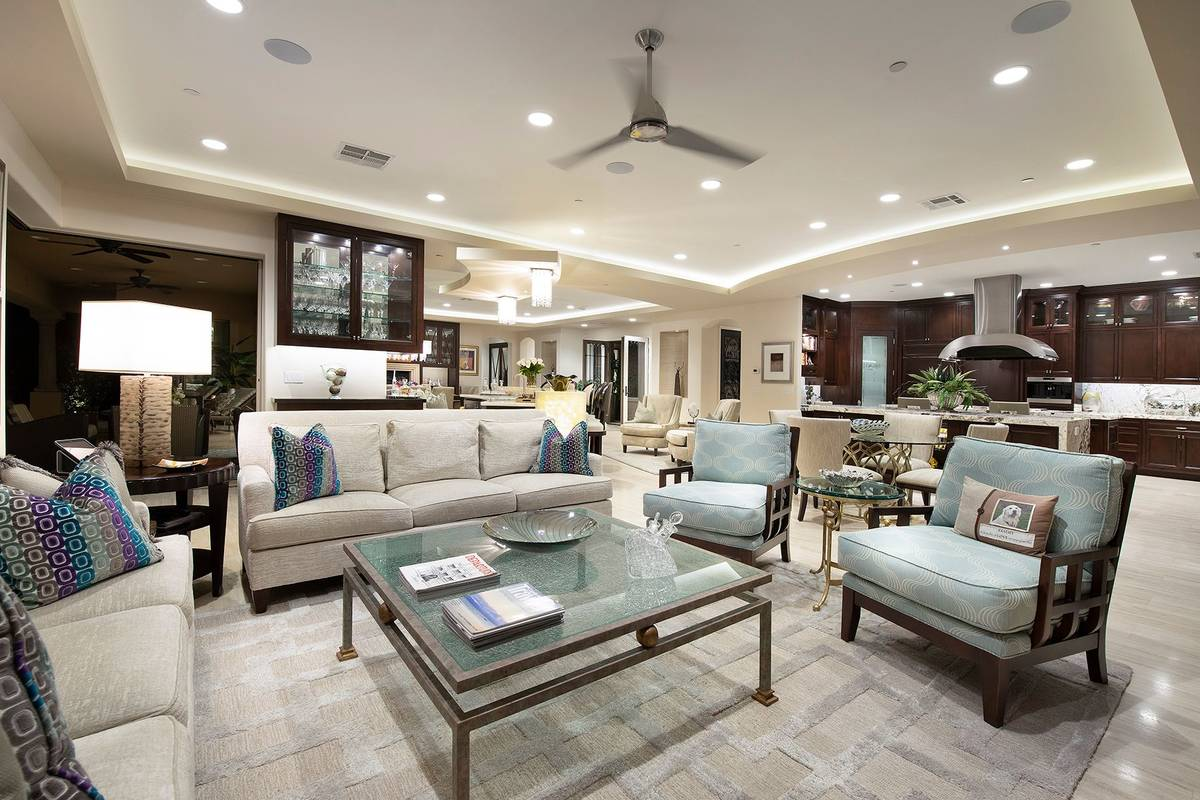The living room is open and shows off the modern feel of the Lake Las Vegas Tuscan-style retrea ...