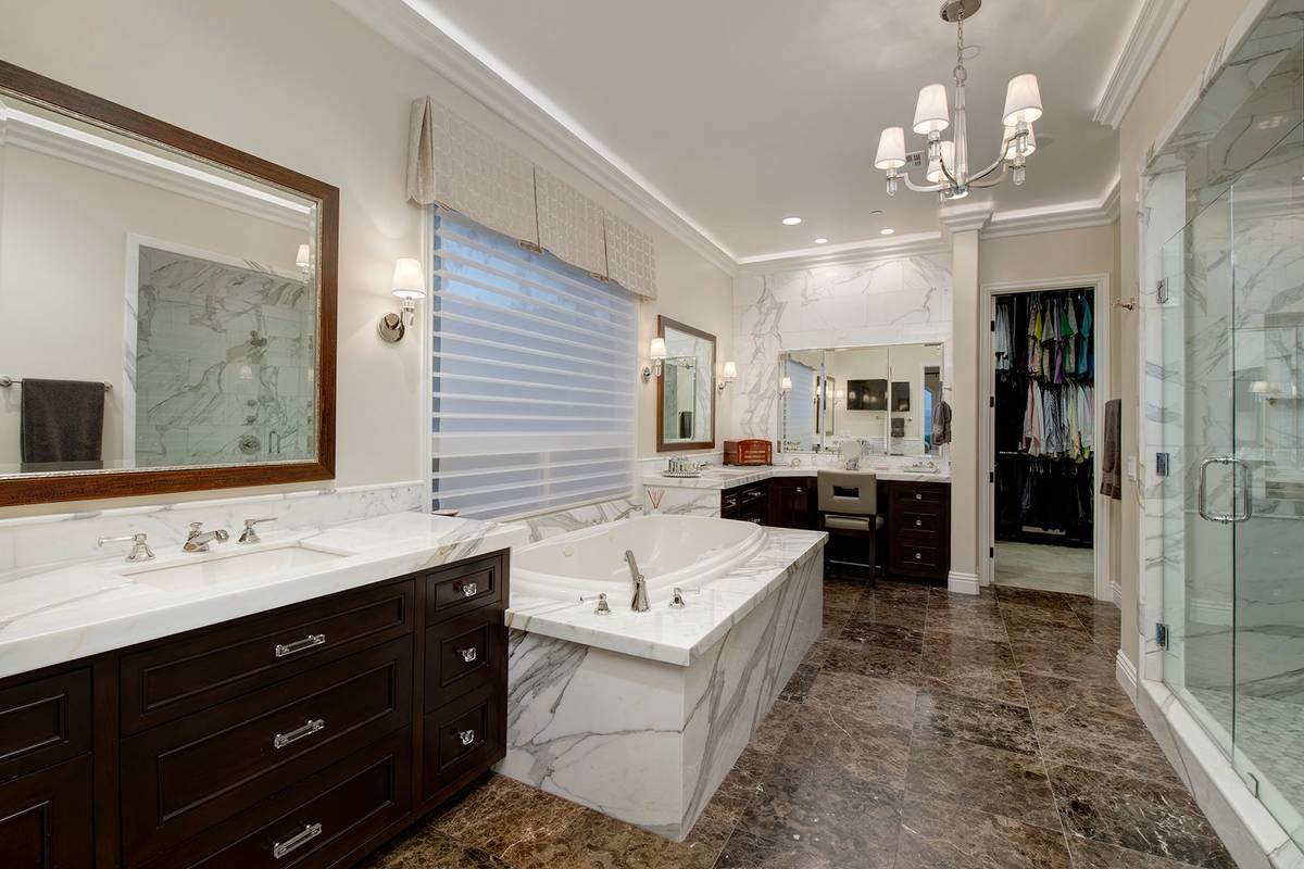 The master bath was remodeled and features spa-quality features and a soaking tub. (Synergy Sot ...