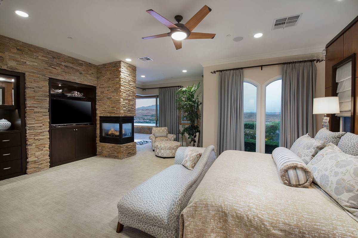 The remodeled master suite features a fireplace, lounge area and a balcony with views of the la ...