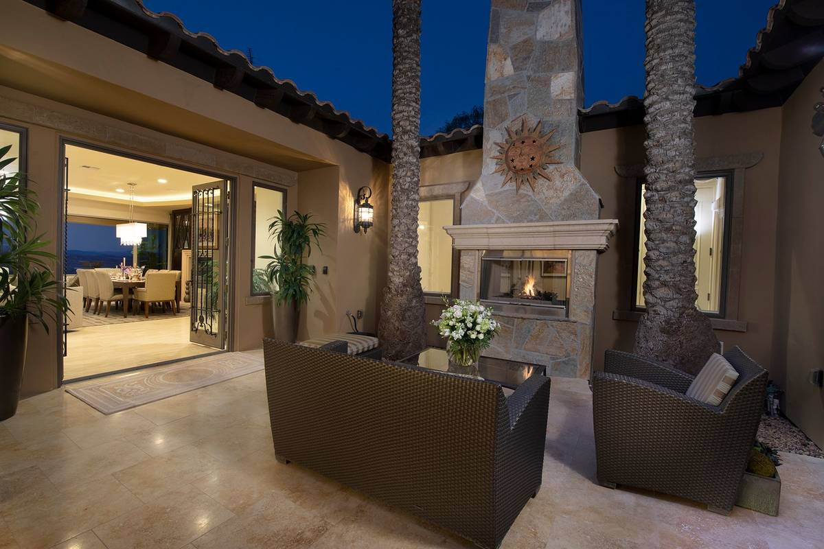 The outdoor patio features a fireplace. (Synergy Sotheby's International Realty)