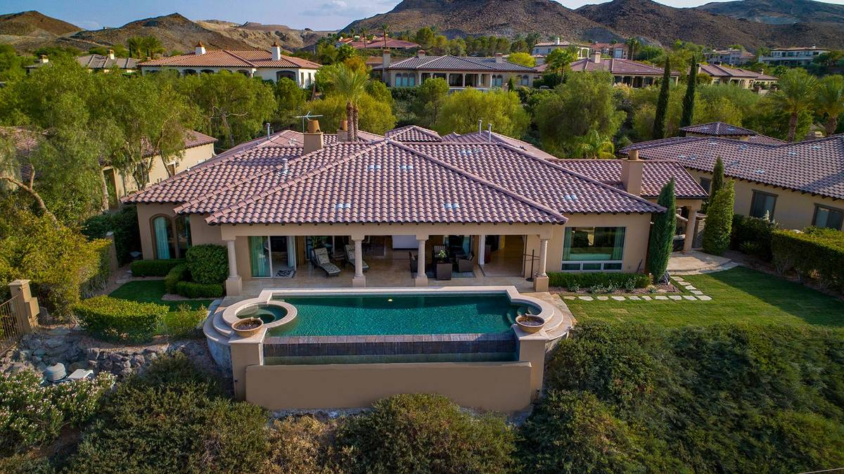The home has a large pool. (Synergy Sotheby's International Realty)