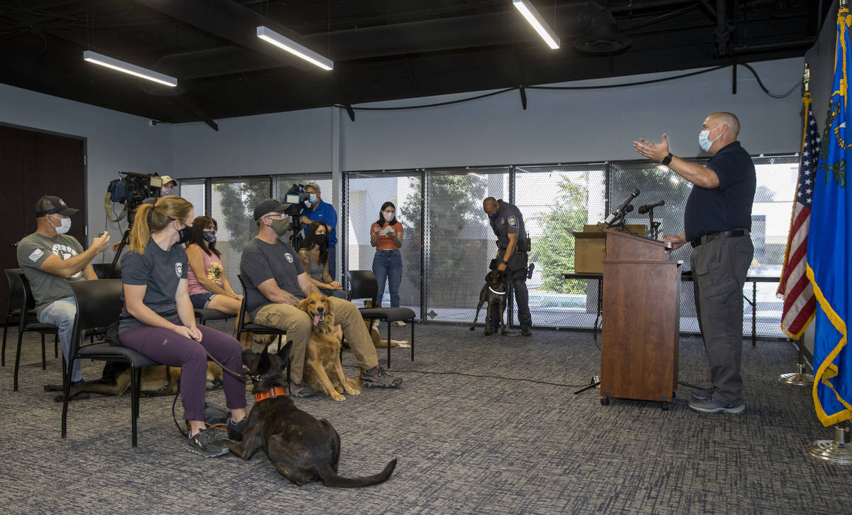 Trainer Cameron Ford with Ford K-9, right, conducts a graduation ceremony for Nevada Highway Pa ...
