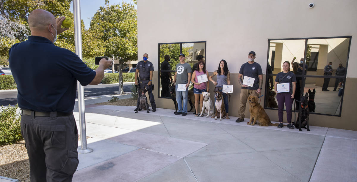 Trainer Cameron Ford with Ford K-9, left, takes a group photo following a graduation ceremony f ...